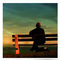 Easing into the dream. Man sitting on a bench.