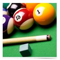 Billiard balls and cue.